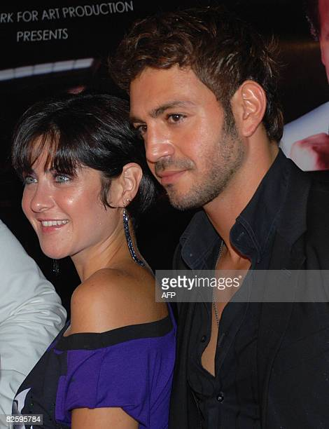Egyptian Actress Heidi Karam poses with Lebanese Singer Ewan in Cairo late 28 August 2008 A press conference was held to launch a new suspence movie...