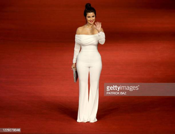 Egyptian actress Hoda Eletreby walks the red carpet of the 4th edition of the Gouna Film Festival at the Red Sea resort of El-Gouna on October 2020....
