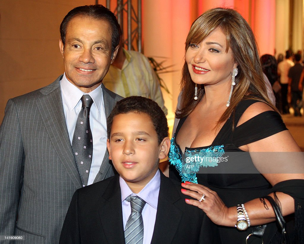 Egyptian actress Leila Elwi poses for a picture with her husband Mansoor  alGamal and son Khaled