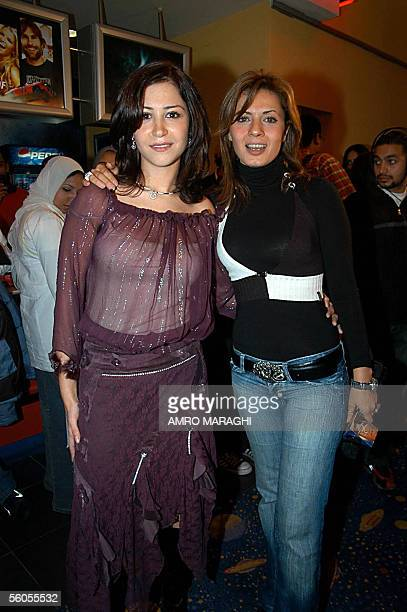 Egyptian actress Minnah Shalabi and TV presenter Najla Badr pose for a picture during the screening of Shalabi's new movie Downtown Girls or Banat...