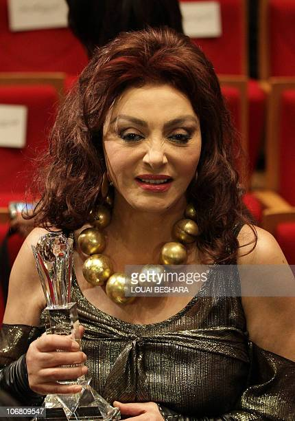 Egyptian actress Nabila Obeid accepts an award on the final day of the Damascus International Film Festival in the Syrian capital on November 13 2010...