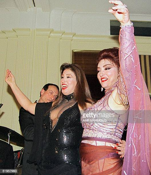 Egyptian actress Nabila Obeid dances with belly dancer Fifi Abdo late 18 February 2000 during Obeid's birthday party at the Sheraton Hotel in Cairo...