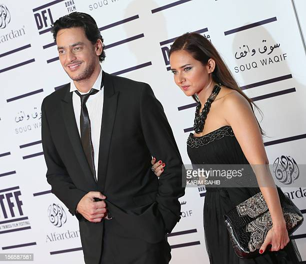 Egyptian actress Nelly Karim and Khaled Abul Naga attends the opening night ceremony of the Doha Tribeca Film Festival in the Qatari capital on...