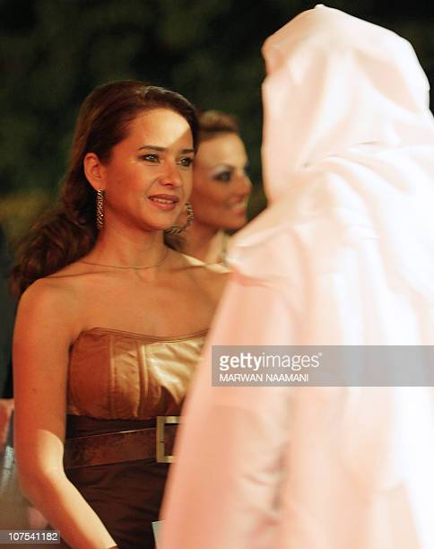 Egyptian actress Nelly Karim is greeted by an Emirati official upon her arrival to attend the opening ceremony of the Dubai International Film...
