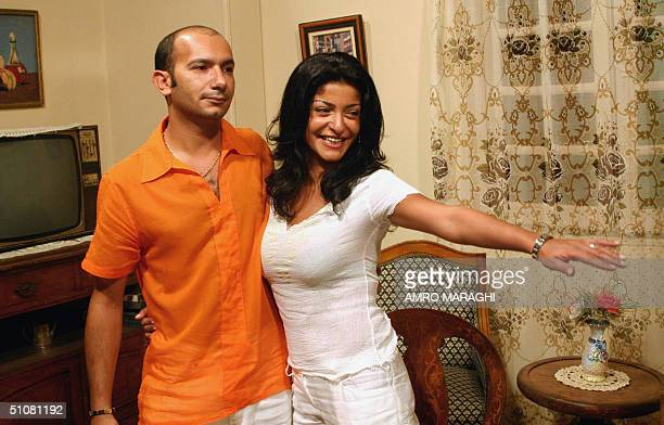 Egyptian actress Oula Ghanem and her husband Ahmad AlMsalami pose during the first day shooting of Oula's new film Seid ElYamam at Studio Misr in...