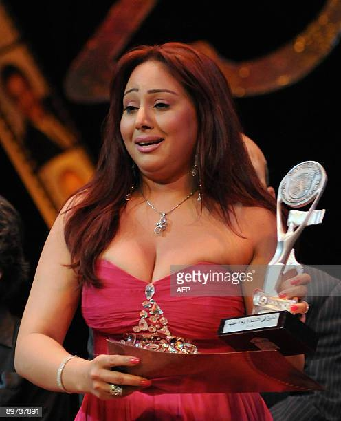 Egyptian actress Rahab alGamal holds her award after winning in the best new actress category for her role in 'Ehki Ya Shahrazad' at the closing...