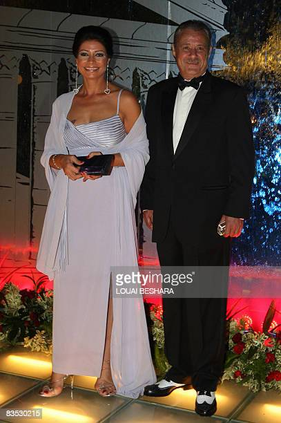 Egyptian actress Sawsan Badr poses with fellow actor Faruq alFishawi during the opening ceremony of the 16th Damascus International Film Festival in...