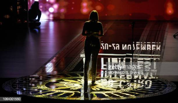 Egyptian actress Sherine Reda stands on-stage while presenting during the opening ceremony of the 40th edition of the Cairo International Film...