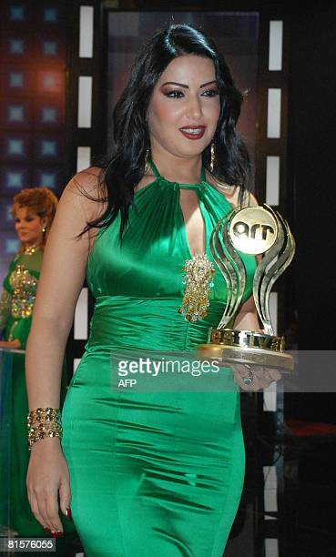 Egyptian actress Somaya al-Khashab receives an award for her role in the controversial Egyptian film 'Hina Maysara' at the ART film awards night in...