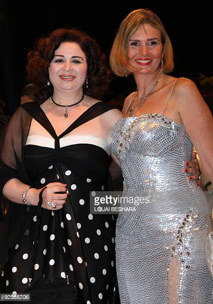 Egyptian actresses Elham Shahine and Yusra arrive to the opening ceremony of the 17th Damascus International Film Festival in the Syrian capital on...