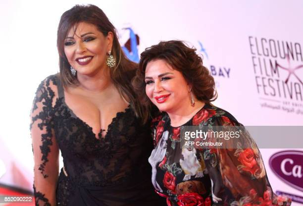 Egyptian actresses Hala Sedki and Elham Shahin pose for photos during the opening ceremony of the first edition of the ElGouna Film Festival in...