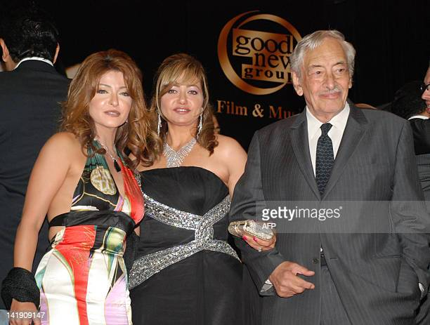 Egyptian actresses Ola Ghanem and Leila Elwi and veteran actor Jamil Rateb pose together during a party after a special screening of the awardwinning...