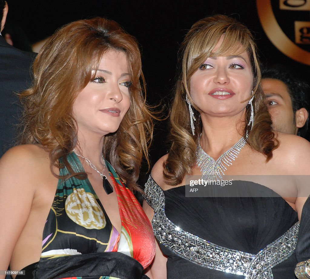 Egyptian actresses Ola Ghanem and Leila Elwi pose together during a party  after a special screening