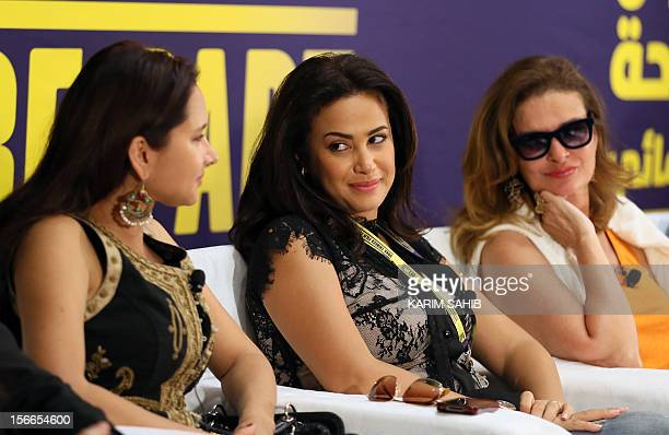 Egyptian actresses Yusra and Nelly Karim sit along side Tunisian actress Hind Sabry during the Doha Tribeca Film Festival in the Qatari capital on...