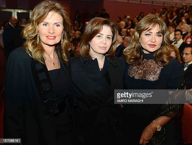 Egyptian actresses Yusra Elham Shahin and Leila Alwi pose for a photograph at the 35th Cairo International Film Festival in the Egyptian capital on...