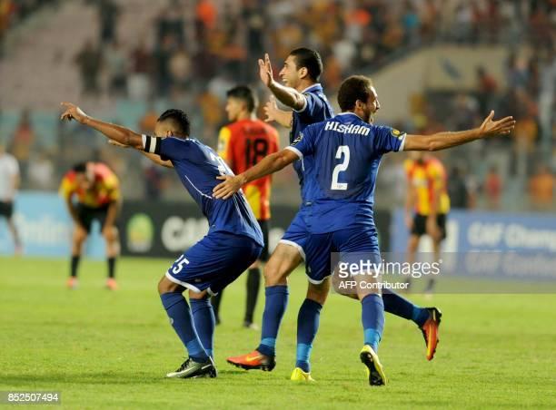 Egyptian Ahly Cairo players hug their team captain Hossem Ashour after scoring against Tunisian Esperance de Tunis during the final quart football...