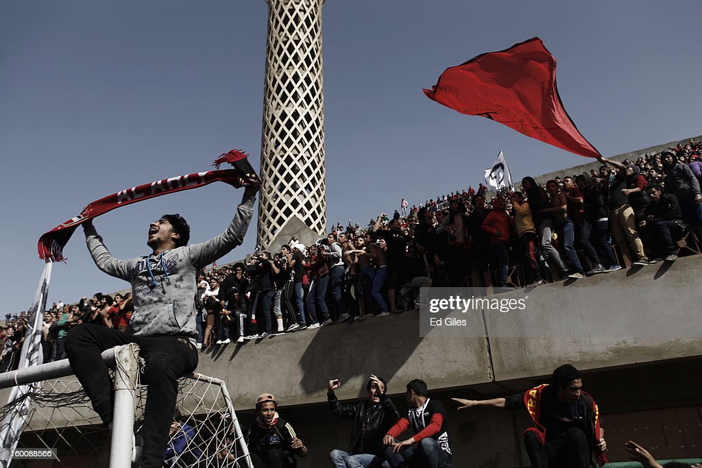 Egyptian 'Ahly Ultra' soccer fans gather at the Al Ahly home stadium during celebrations after the announcement that 21 fans of the Al Masry football club involved in a football stadium massacre last year were sentence to death on January 26, in Cairo, Egypt. A verdict was announced Saturday in a case over the deaths of more than seventy fans of Egypt's Al-Ahly football club in a stadium massacre on February 1, 2012, in the northern city of Port Said, during a riot that began minutes after the final whistle of a match between Al-Ahly and Al-Masry. 21 fans of the Al Masry football club were given the death penalty in the court case, a verdict that must now be approved by Egypt's Grand Mufti. The verdict was handed down during a period of high tension across Egypt, one day after the second anniversary of the beginning of Egypt's 2011 revolution that overthrew the regime of former President, Hosni Mubarak.