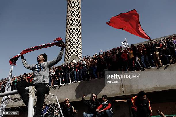 Egyptian 'Ahly Ultra' soccer fans gather at the Al Ahly home stadium during celebrations after the announcement that 21 fans of the Al Masry football...