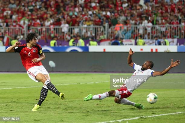Egyptian Ahmed Hegazi hits the ball during the World Cup 2018 Africa qualifying match between Egypt and Congo at the Borg elArab stadium in...