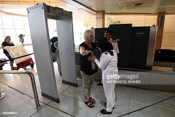 Egyptian airport security bodycheck a tourist at the airport in Egypt's Red Sea resort of Sharm ElSheikh on November 6 2015 Britain moved to...