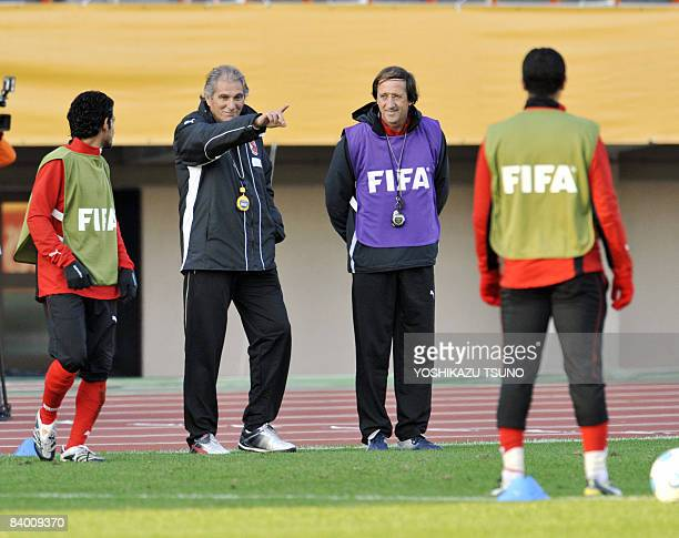 Egyptian Al Ahly football club head coach Manuel Jose gives instructions to his players during an official training session at Japan's national...