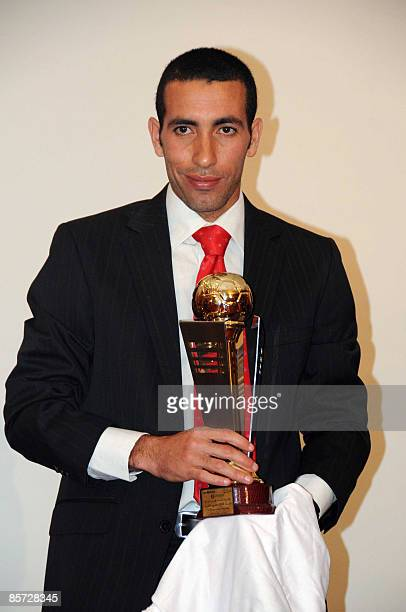 Egyptian Al Ahly striker Mohammed Aboutrika poses on March 30 2009 after receiving the award of best 2008 Arabic football player during a ceremony in...