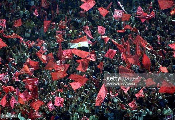 Egyptian alAhli fans wave national and red flags following their team's victory over South Africa's Kaizer Chiefs in Cairo 15 March 2002 AlAhli won...