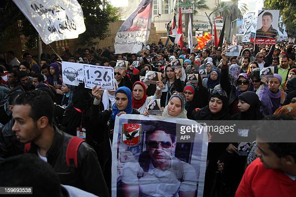 Egyptian alAhly football club ultras and protesters hold portrait of the victims the 2012 Port Said football match killings during a demonstration...