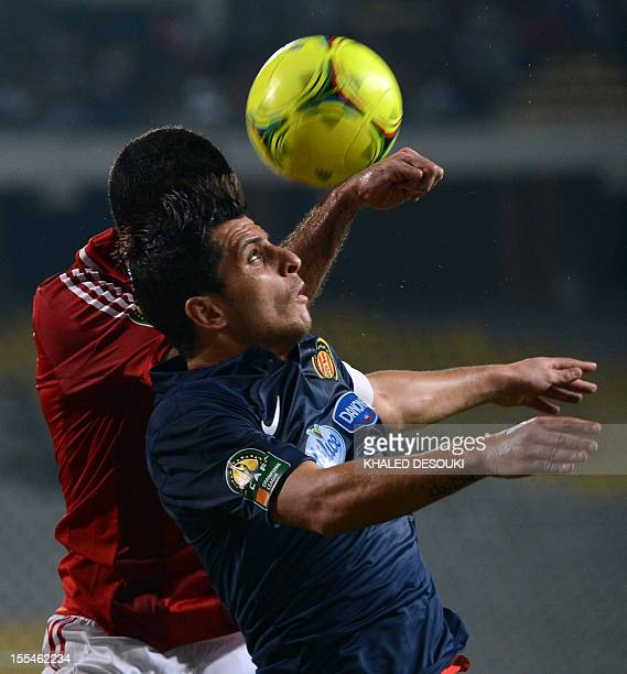 Egyptian AlAhly's Mohamed Aboutrika vies for the ball with Tunis's Khalil Chemmam of Esperance de Tunis during their CAF Champions League final first...