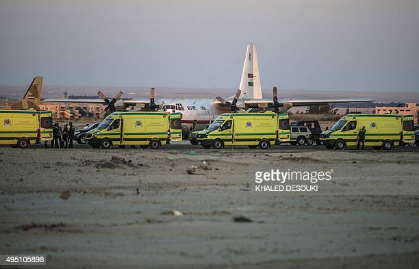 Egyptian ambulances wait at Kabret military air base by the Suez Canal on October 31 after victims of a Russian airliner that crashed in the Sinai...