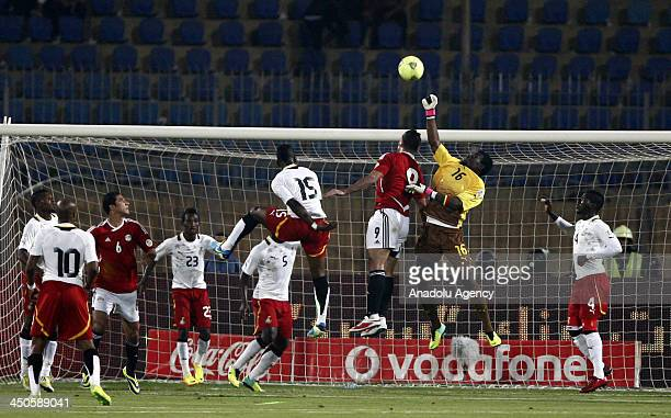 Egyptian Amr Zaki fights for the ball during the FIFA World Cup 2014 African zone football qualifier second leg playoff on November 19 2013 in Cairo...