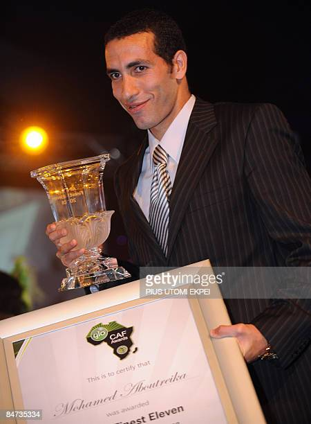 Egyptian and AlAhly striker Mohammed Aboutreika holds the InterClub Player of the Year Award at the Confederation of African Football awards ceremony...