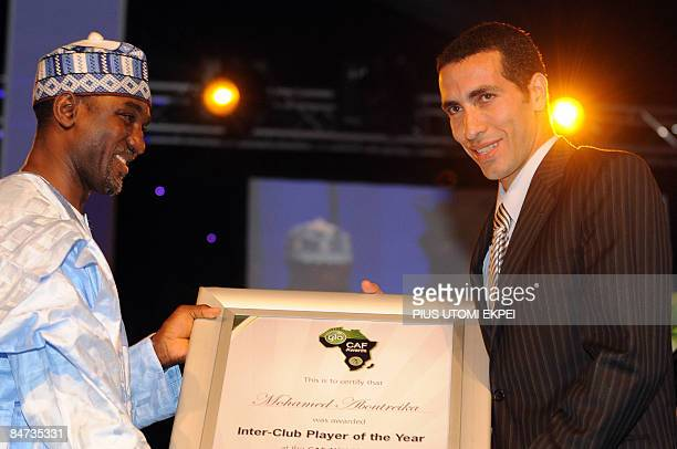 Egyptian and AlAhly striker Mohammed Aboutreika receives the InterClub Player of the Year Award from Menassara Illoh at the Confederation of African...
