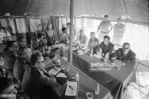 Egyptian and Israeli representatives gather around the table at the location 101 kilometers from Cairo where the Israeli forces ceased their advance...
