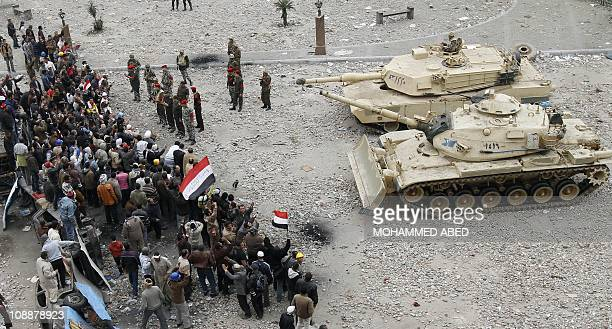 Egyptian antigovernment demonstrators face army tanks in Cairo's Tahrir square on February 05 as Egyptians gather for the 12th consecutive day...