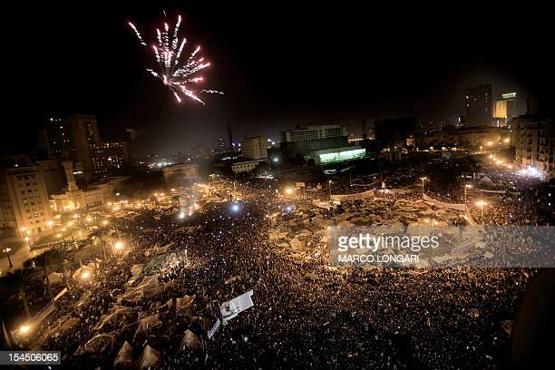 Egyptian anti-government protesters celebrate under fireworks at Cairo's Tahrir Square after president Hosni Mubarak stepped down on February 11,...