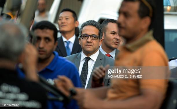 Egyptian Antiquities Minister Khaled elEnany watches as the gilded bed and chariot of the ancient Egyptian boyking Tutankhamun arrive upon their...