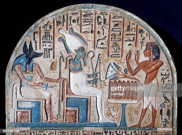 Nanai stele depicting Nanai worshiping the Gods Osiris and Anubis the dead deity who holds the key of life ankhshaped Limestone painted End of the...