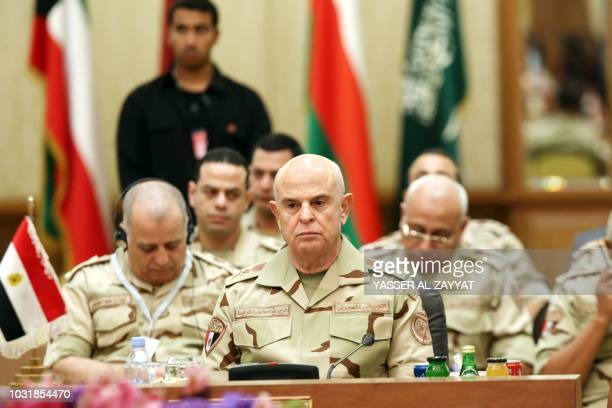 Egyptian armed forces Chief of Staff Mohamed Farid Hegazy listens during a Gulf cooperation council's armed forces chiefs of staff and the commander...