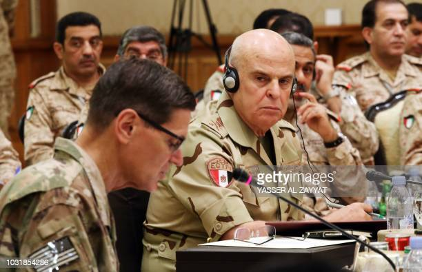 Egyptian armed forces Chief of Staff Mohamed Farid Hegazy looks on as Joseph Leonard Votel Commander of United States Central Command speaks during a...