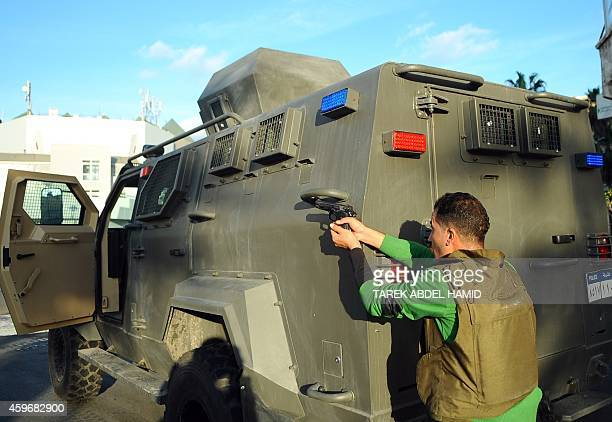 Egyptian army and police exchange fire with an armed man on the top of a building in Alexandria on November 28 2014 Firing came from the building...