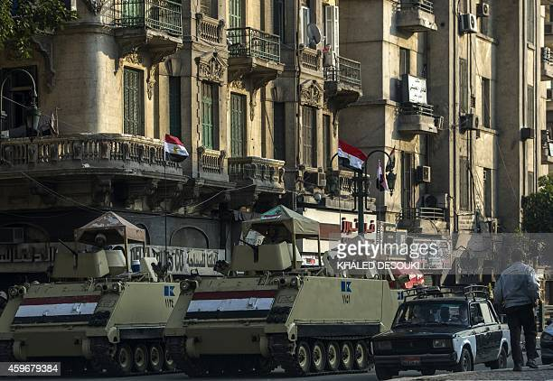 Egyptian army armoured personnel carriers are parked in Cairo's Tahrir Square on November 28 ahead of planned Islamist protests that have prompted...