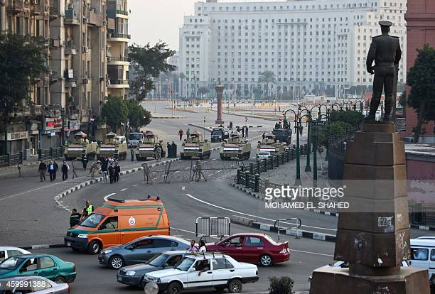 Egyptian army blocks a road leading to Cairo's landmark Tahrir Square on December 5 during a demonstration against a court's decision to drop a...