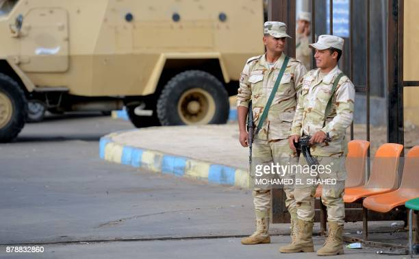 Egyptian army conscripts stand guard outside the Suez Canal University hospital in the eastern port city of Ismailia on November 25 where the victims...