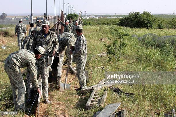 Egyptian army soldiers participate in the construction of a fence following a parallel road to the Philadelphi corridor a buffer zone that separates...