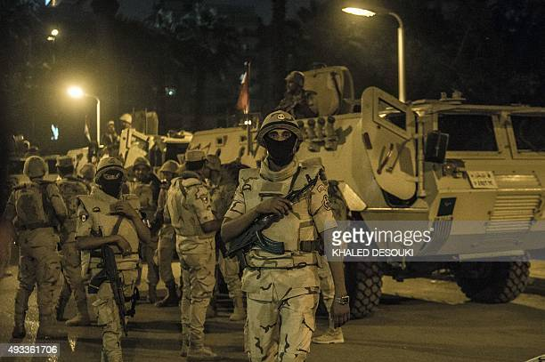 Egyptian army stand guard outside a polling station during the counting of ballots at the end of the first round of voting for Egypt's parliamentary...