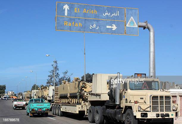 Egyptian army tanks are brought into the Egyptian side of Rafah on the border with the Gaza Strip on November 8 days after three policemen were...