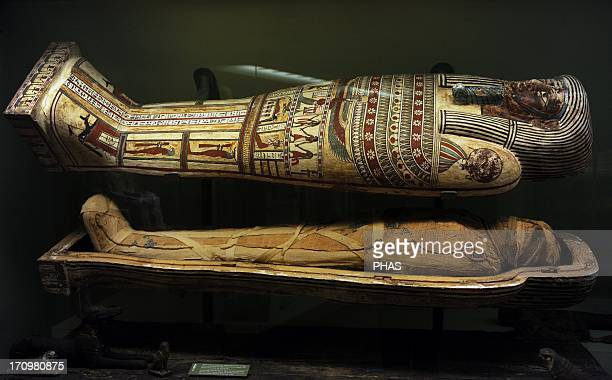 Egyptian art Sarcophagus with mummy Anubisjackal and sokarfalcons Figures like these were placed upon the coffin in the Late Period The BaBird...