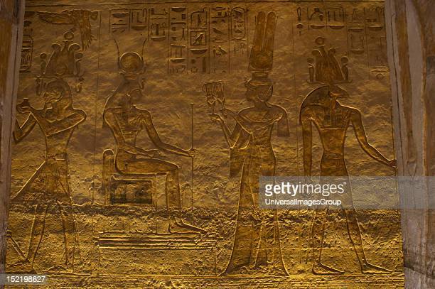 Egyptian art Small Temple or Temple of Hathor 19th dynasty New Empire Relief depictingNefertari offering sinistrums to seated goddess Hathor Abu...