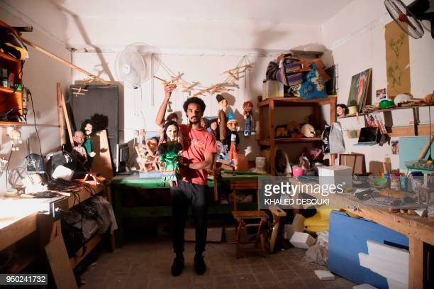 Egyptian artist and marionette maker Mohamed Fawzi Bakkar poses for a picture at his workshop in Cairo on April 22 2018 Ahead of May Day AFP's video...